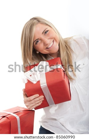 Laughing blonde young woman holding a present