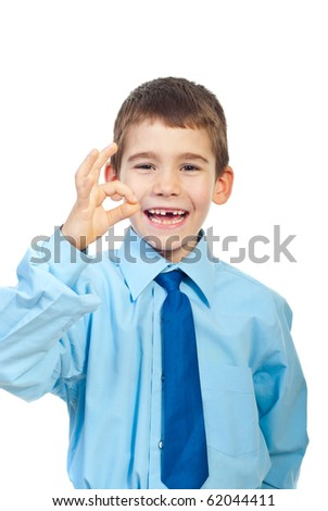 Laughing boy with missing teeth showing okay sign hand  isolated on white background - stock photo