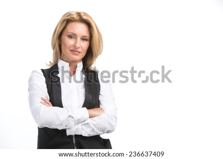 Laughing business woman in white shirt. Attractive mature businesswoman on white background with folded hands - stock photo