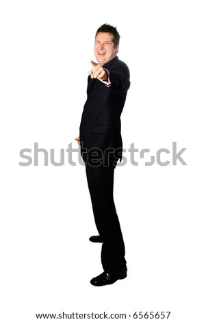 Laughing businessman pointing a finger towards something, isolated on white.