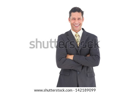 Laughing businessman with crossed arms and white background