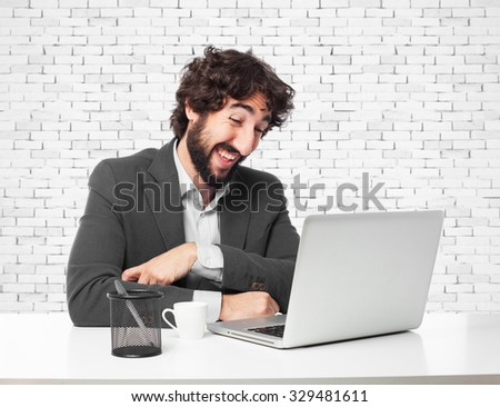 laughing businessman with laptop - stock photo