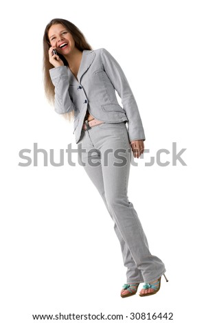 Laughing businesswoman in a suit talks on a mobile phone, isolated on white