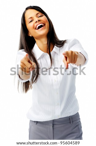 Laughing businesswoman points to target in studio, isolated on white - stock photo