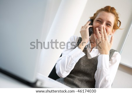 laughing businesswoman talking phone - stock photo