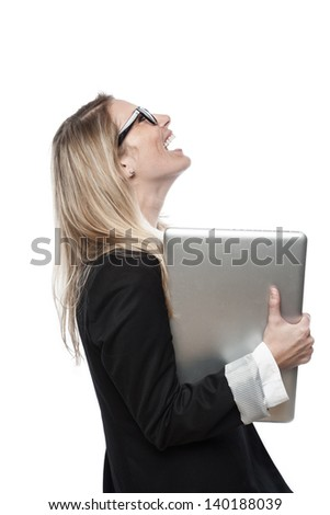 Laughing businesswoman wearing glasses looking up while holding a laptop in her hand, profile portrait isolated on white - stock photo