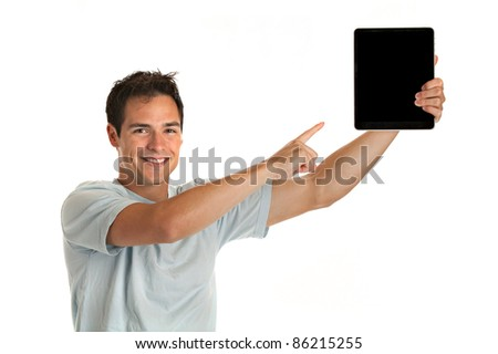 Laughing Casual Young Man Holding a Touch Pad Tablet PC on Isolated White Background