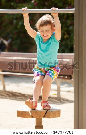 Laughing child  at playground  in sunny summer day  - stock photo