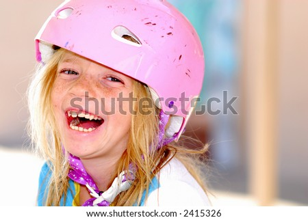 Laughing child with a safety helmet
