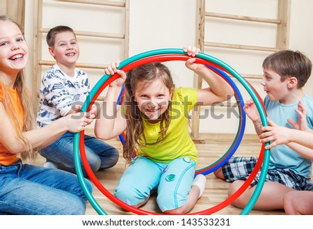Laughing children playing in a gym - stock photo