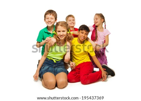 Laughing children sitting on the floor together