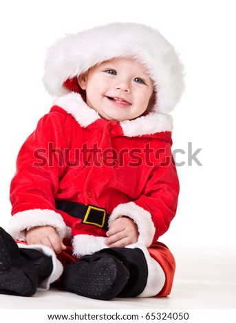 Laughing Christmas baby - stock photo