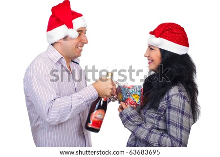 Laughing Christmas couple standing face to face holding champagne and gift and having funny conversation isolated on white background