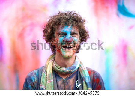 Laughing clown portrait against colorful background - stock photo