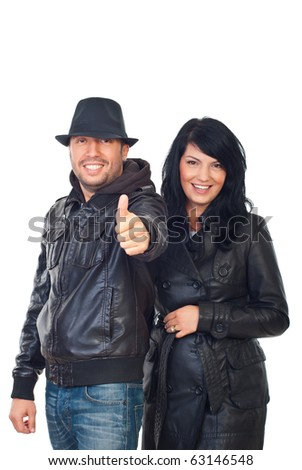 Laughing cool couple in leather jackets giving thumbs up isolated on white background