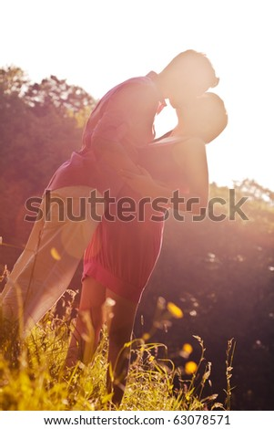 Laughing couple outdoors making break - stock photo