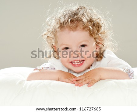 Laughing curly babe - stock photo