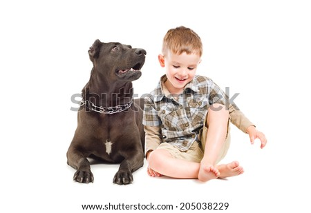 Laughing cute boy and big dog sitting together - stock photo