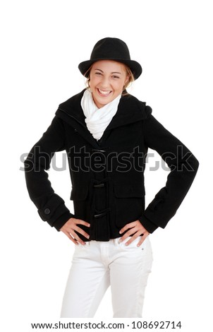 Laughing female teen in winter clothing