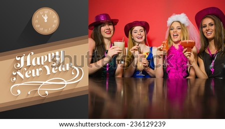 Laughing friends having hen party holding cocktails against classy new year greeting - stock photo