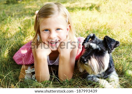 laughing girl and her trusty miniature schnauzer - stock photo