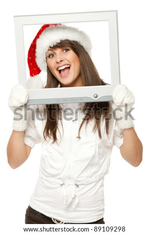 Laughing girl in Santa hat broadcasting Christmas news from TV / computer screen, isolated on white background. Christmas news. - stock photo