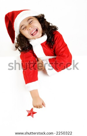 Laughing girl in Santa?s costume with star