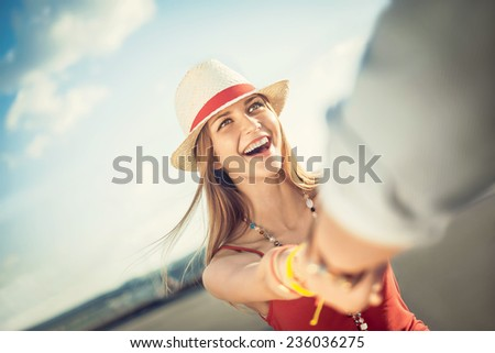 Laughing girl in the street - stock photo