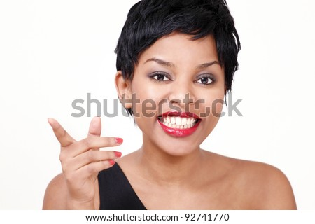 Laughing girl pointing finger - stock photo