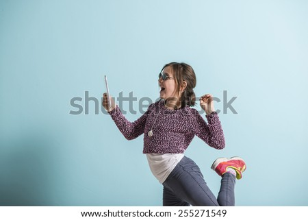Laughing girl reading funny text message - stock photo