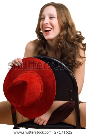 Laughing girl with a red hat sits astride on a chair. Isolation on a white background - stock photo