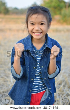 Laughing girl with handful success