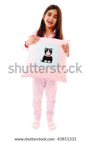 Laughing girl with pillow isolated on white