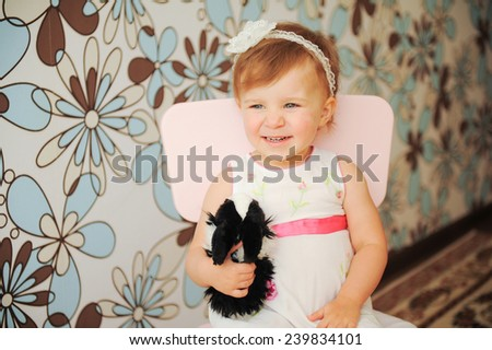 laughing girl with rabbit at home - stock photo