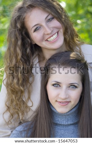laughing girls in garden - stock photo