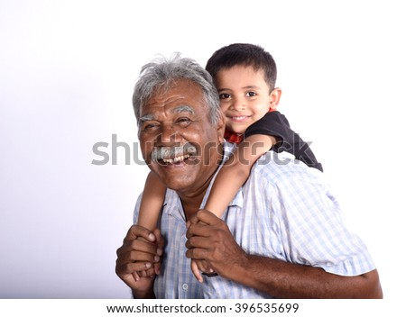 Laughing grandfather with his grandson as they play together