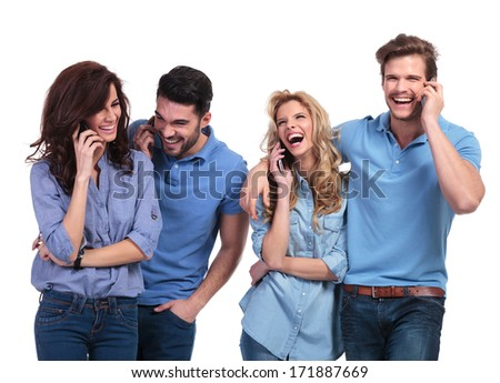 laughing group of casual people speaking on phone on white background - stock photo