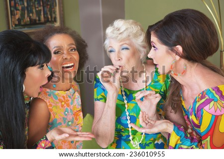 Laughing group of women smoking a joint - stock photo