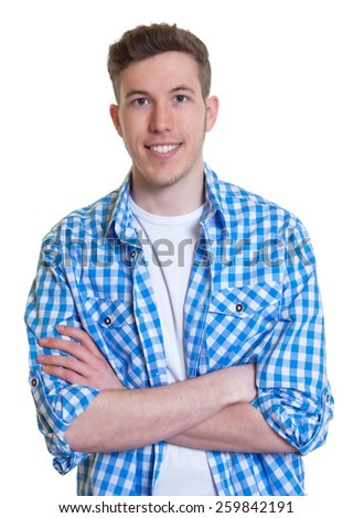 Laughing guy in a checked shirt with crossed arms - stock photo
