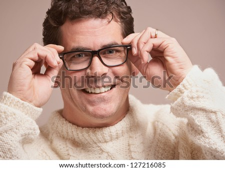 Laughing handsome man holding glasses closeup - stock photo