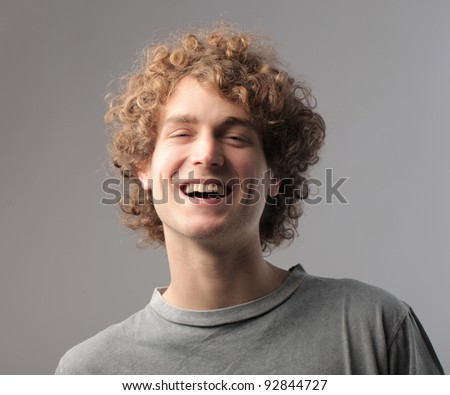 Laughing handsome young man - stock photo