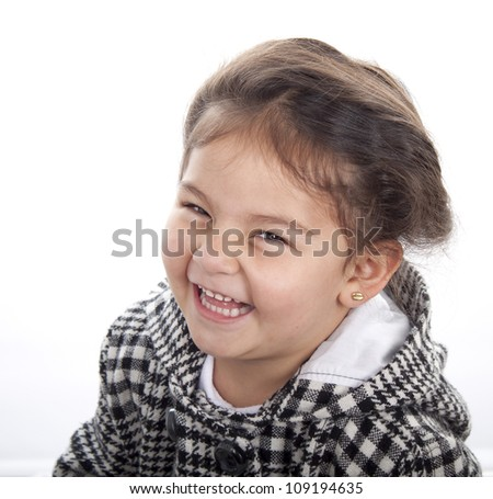 Laughing happy girl on bright background