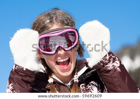 Laughing happy girl on winter sport vacation. Wearing ski mask - stock photo