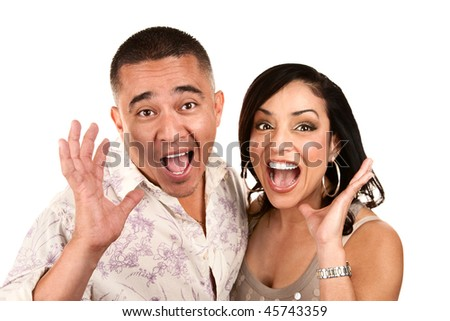 Laughing happy Hispanic couple with surprised expressions