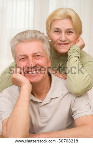 laughing, happy middle-aged men and women together - stock photo
