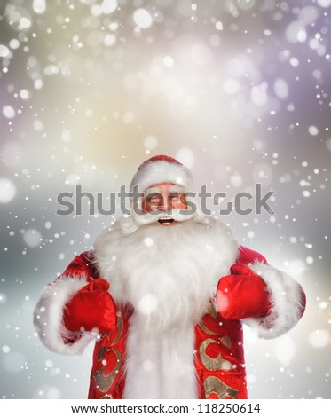 Laughing happy Santa Claus over snowflake background