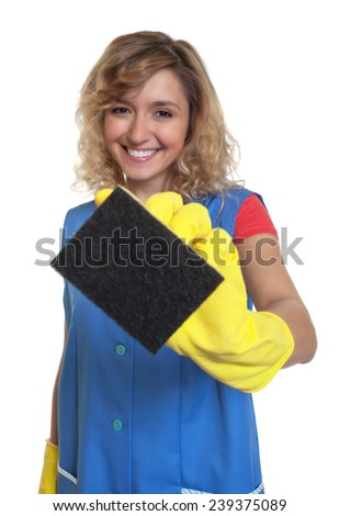 Laughing housewife with blond hair and sponge - stock photo