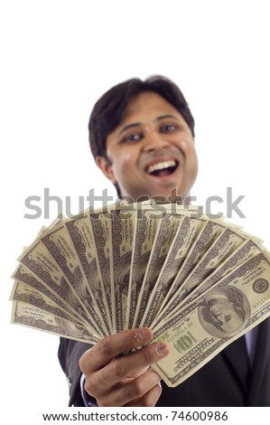 Laughing Indian business man holding a handful of money isolated over white - stock photo