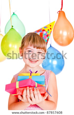 Laughing kid holding birthday presents - stock photo