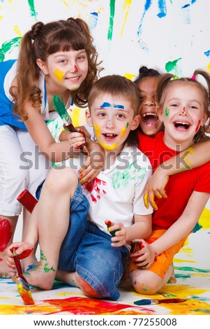 Laughing kids having fun with paints - stock photo